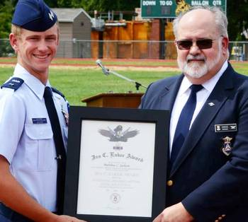 Cadet Lt. Col. Matthew Jackson receives the Gen. Ira C. Eaker Award at the 2015 New Jersey Wing Basic Encampment graduation on Saturday. Presenting the award to Jackson is Col. Joseph Sirois, Northeast Region vice commander south. Earlier today, Jackson learned he is also the 2000th recipient of the Gen. Carl A. Spaatz Award – CAP's highest cadet honor, wh ich carries with it promotion to cadet colonel.